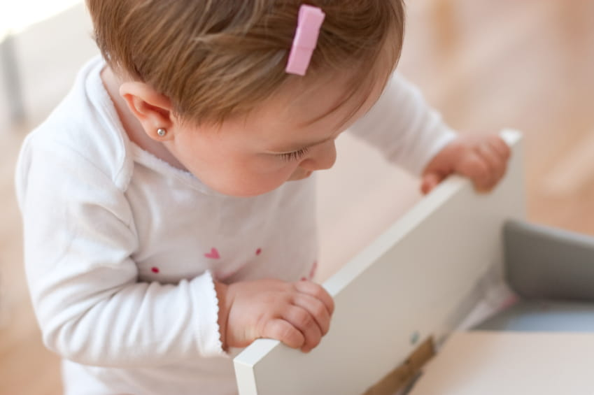 child opening drawer